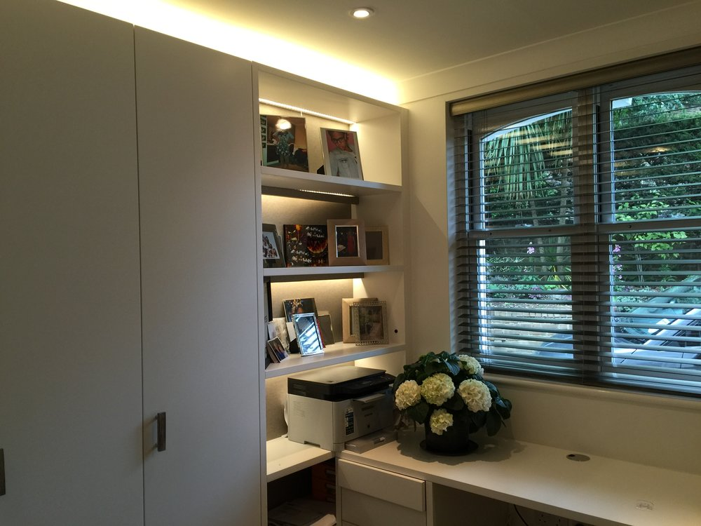 Granville Park  interior design project: bespoke built-in storage with wall covering and  back lit open shelves,  and fossil handles