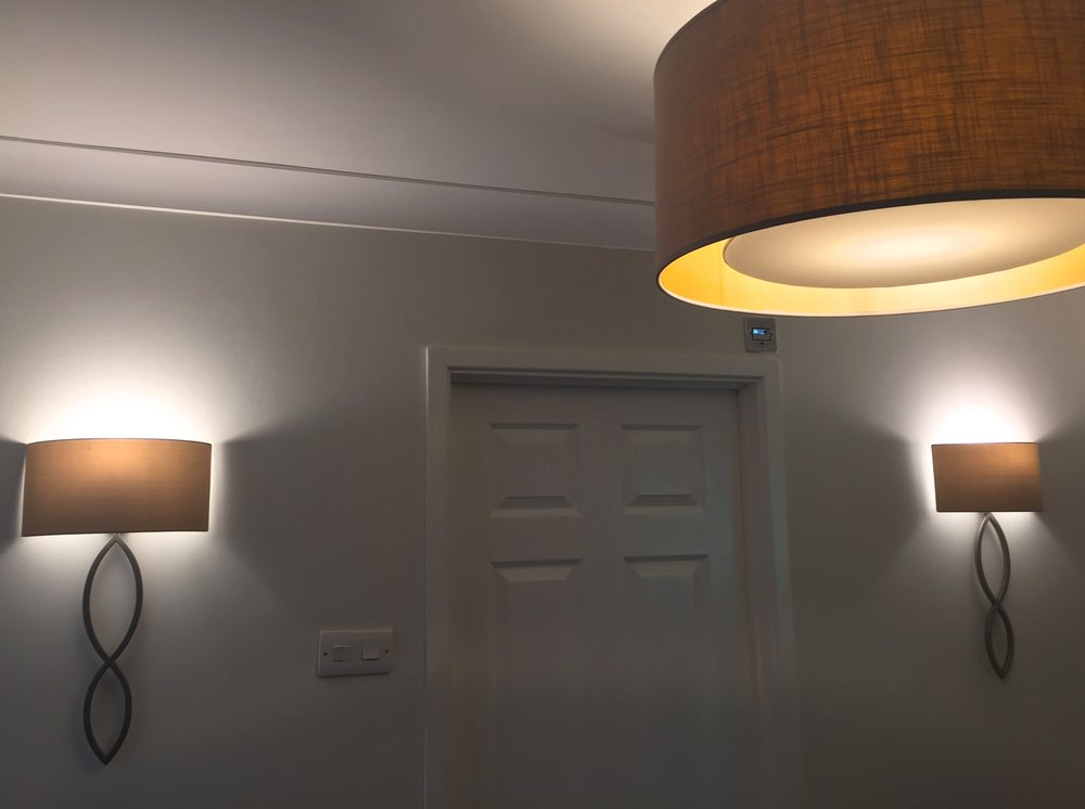Granville Park  interior design project : An elegant Hallway using nickel figurative lights with oyster shades, complimented by a bespoke drum pendent.