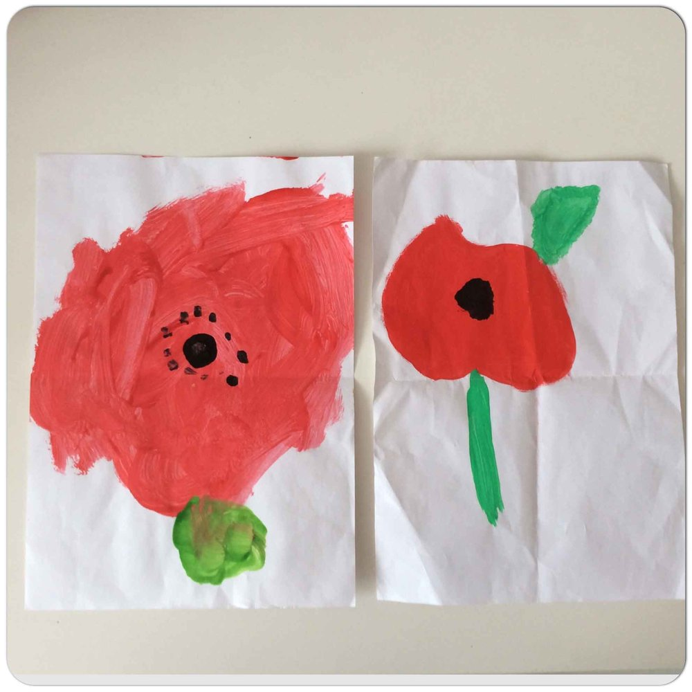 Poppies  - Example of the poppy paintings,left - Reception (age 5), right -Year 4 (age 9)