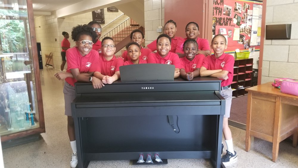 - THE SCHOOL YEAR AT CARDINAL SHEHAN ENDED ON A HIGH NOTE with delivery of this brand new Yamaha electric piano, funded by WEA donors. After hearing that the music program at CSS desperately needed to replace its well-worn keyboards, WEA put out the word. Before long, several generous donors stepped up to make choir director Kenyatta Hardison's dream a reality. Music4More and several other donors also responded with contributions of a variety of musical instruments that were sorely needed. AND THE BEAT GOES ON….THANKS TO YOUR SUPPORT the school's amazing choir and music program will continue to thrive and inspire with their gift of song!