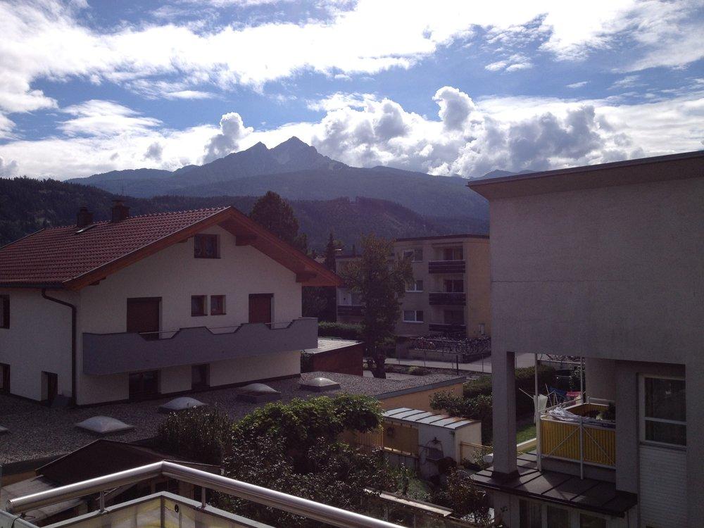 Urban garden and mountains