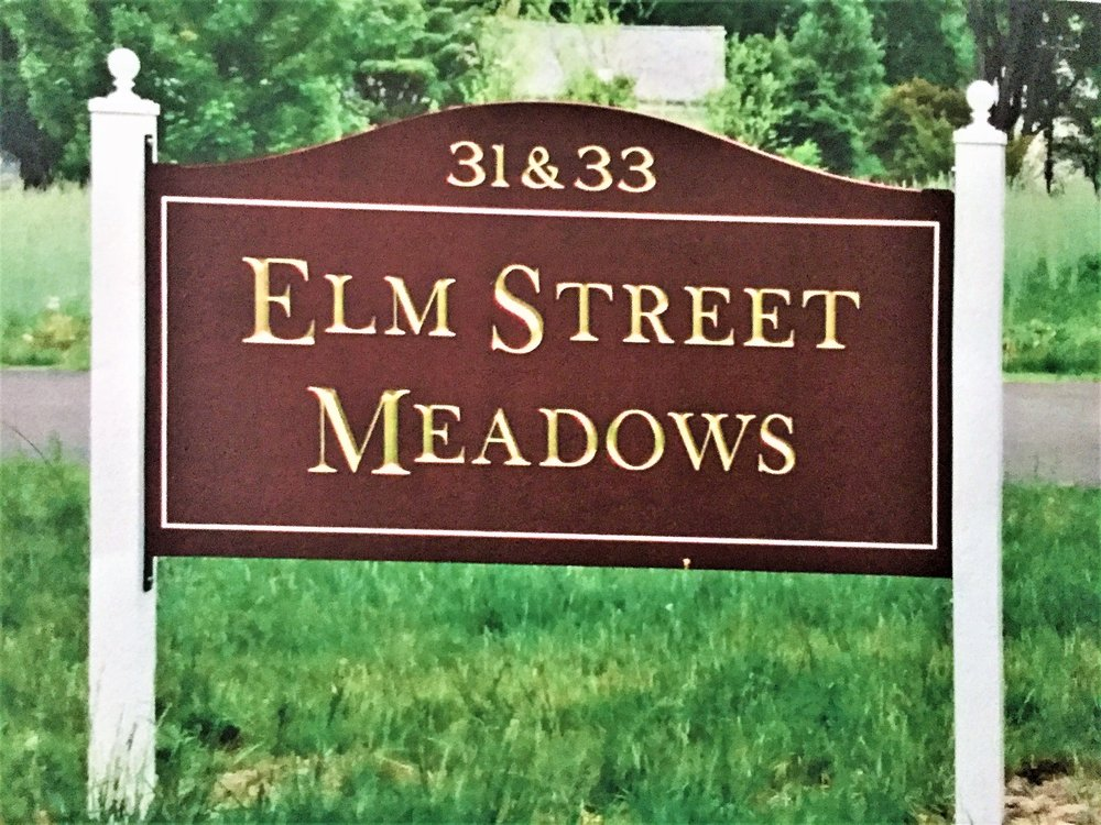 Carved and guilded sign made for Elm Street Meadows in Amherts, MA