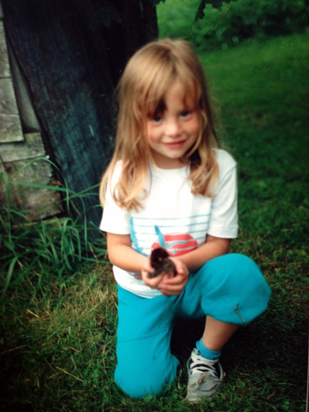 Me as a kiddo holding a chick