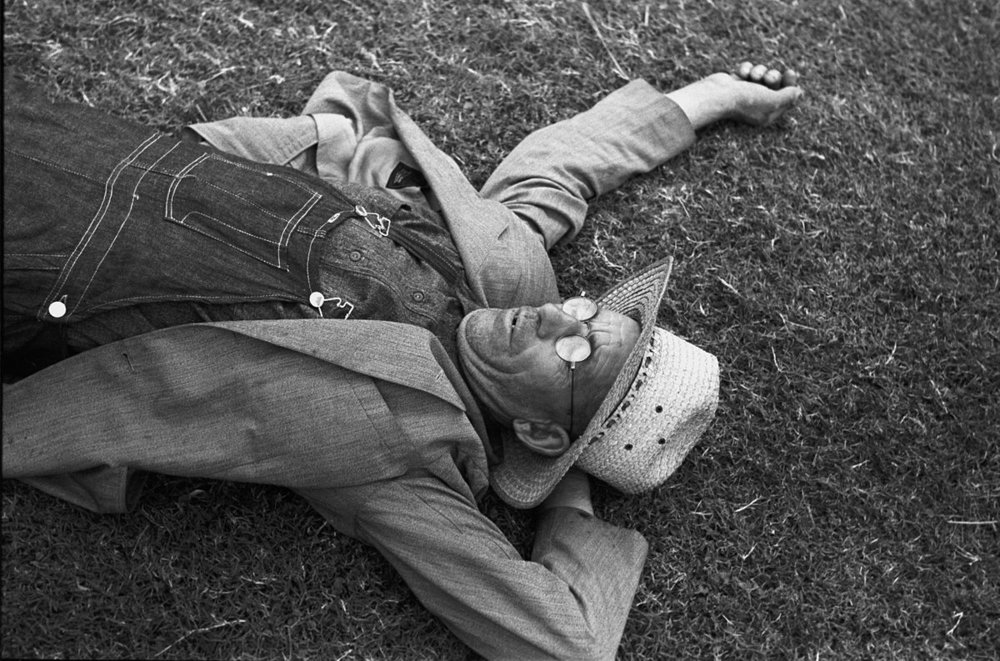 """Farmer at National Rice Festival taking a rest, Crowley, Louisiana"", 1938. Russell Lee [Public domain], via Wikimedia Commons"