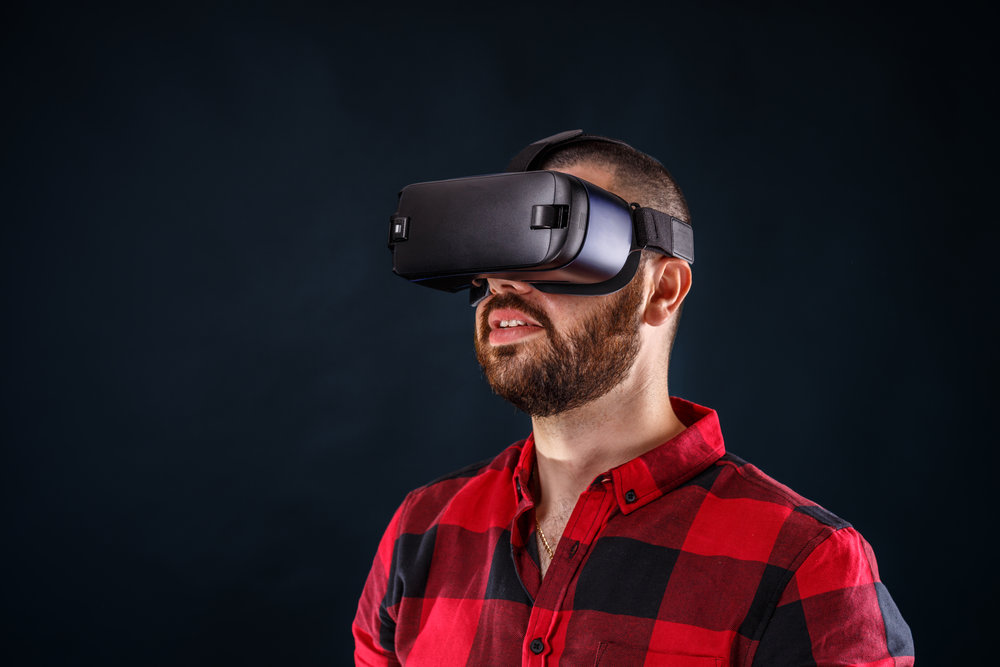 man-wearing-virtual-reality-glasses-P44RB4H.jpg