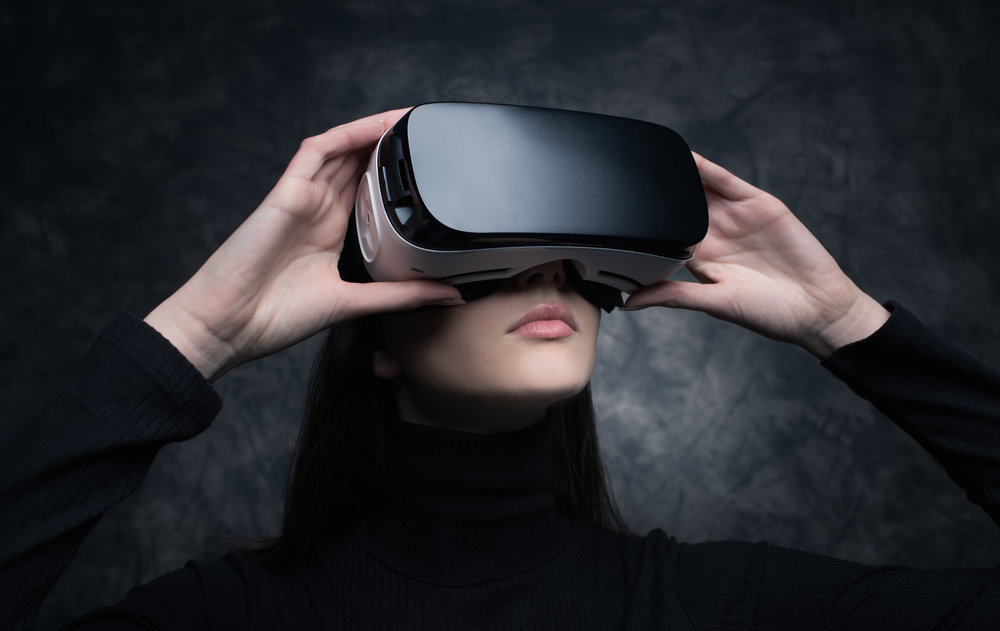 young-woman-with-virtual-reality-headset-PVWVS8V.jpg