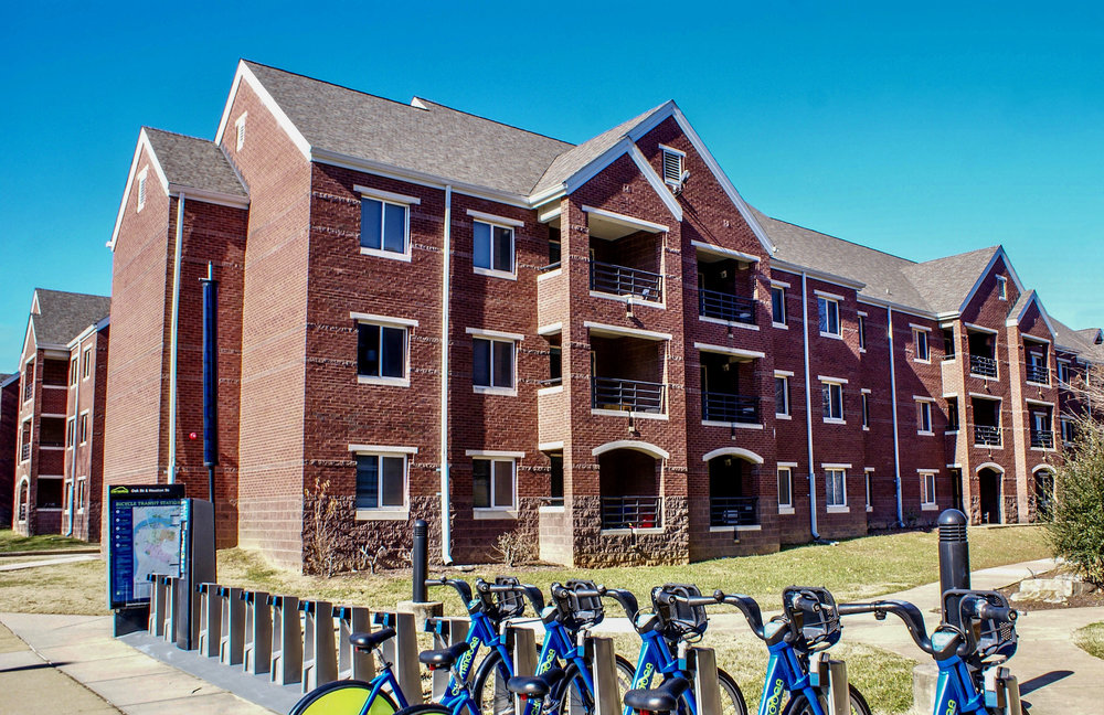 "University of Tennessee at Chattanooga - Johnson Obear Apartments   The Johnson Obear Apartments are a co-ed student housing facility located near the center of campus of the University of Tennessee at Chattanooga on Oak Street. The buildings consists of two different apartment styles with a total number of 450 ""bed spaces"" for students and was completed in 1997. Each apartment offers a full kitchen and living room in addition to the 3 or 4 room layouts with one bathroom. The buildings also offer community spaces, study rooms, laundry facilities, and 1GB fiber optic internet available to all occupants; as well as a beautiful and relaxing courtyard in the center of the connected buildings."