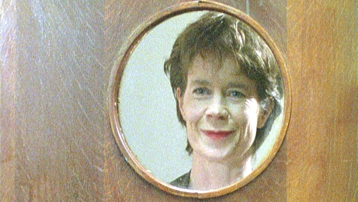 Dr Reed (Celia Imrie) looking thru window.jpg
