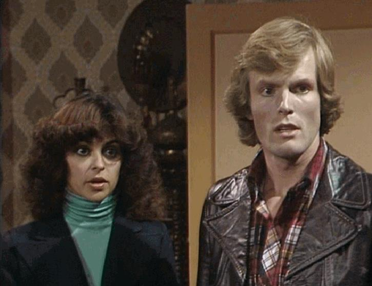 Merlin Ward made many TV appearances often in comedies such as 'Please Sir!' with John Alderton, 'His Lordship Entertains' with Ronnie Barker, and the 'Dick Emery Show'.  In 1977, he was cast as a cockney garage mechanic in the soap 'Crossroads' playing most of his scenes opposite Karan David (pictured).   Subsequent work included 'The Stud' with Joan Collins, 'Carry On Emmannuelle', and the US drama series 'The Love Boat', in which he played a commercials director in a scene with screen legend, Trevor Howard.  Links below: