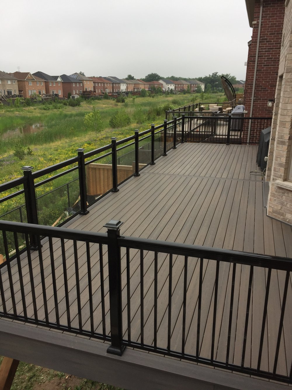 Fiberon Deck with Dalmar Aluminum glass railings.
