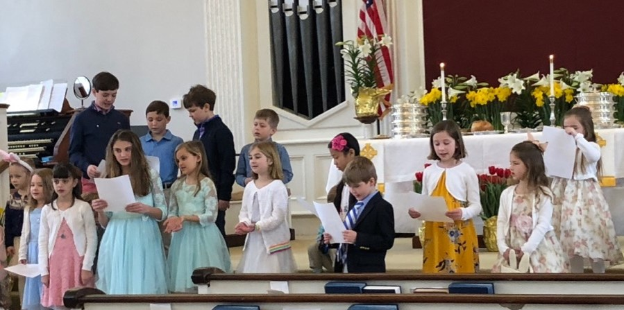 Children singing during the worship.