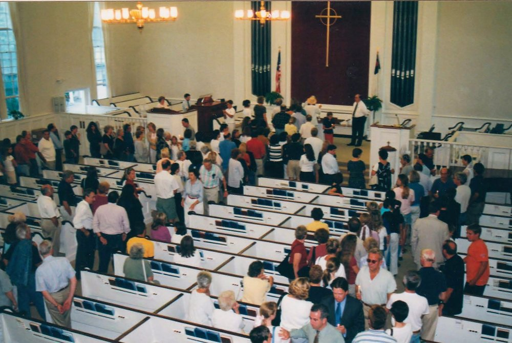 Rev. Ames leading a community    9-11 service    in 2001.
