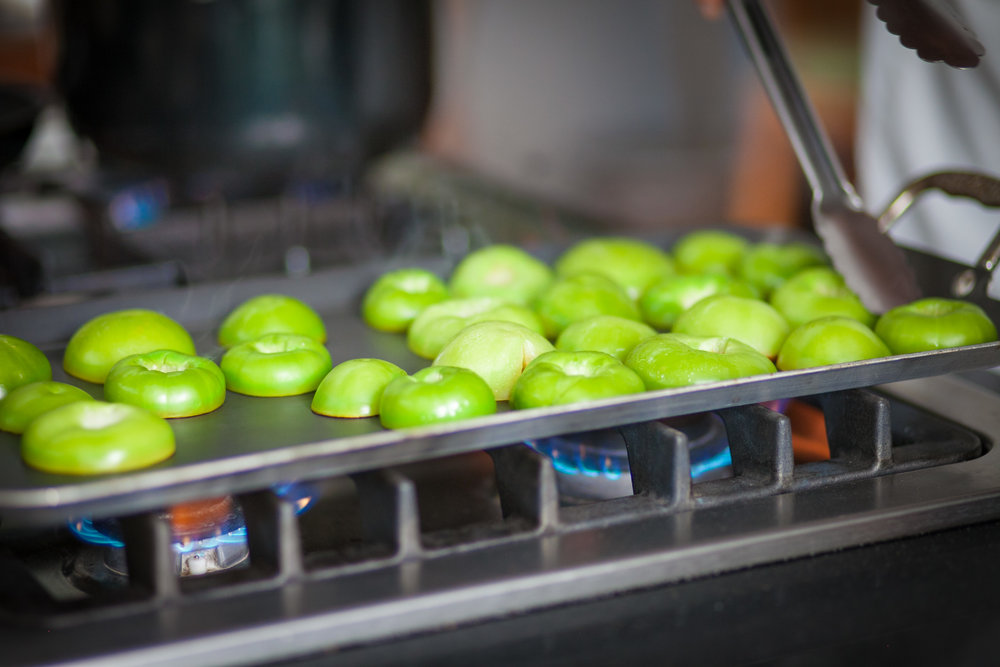 flying apple slices in a cooking class