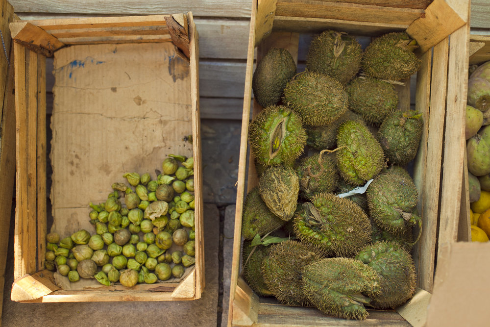 Boxes of tomatillo and chayote.