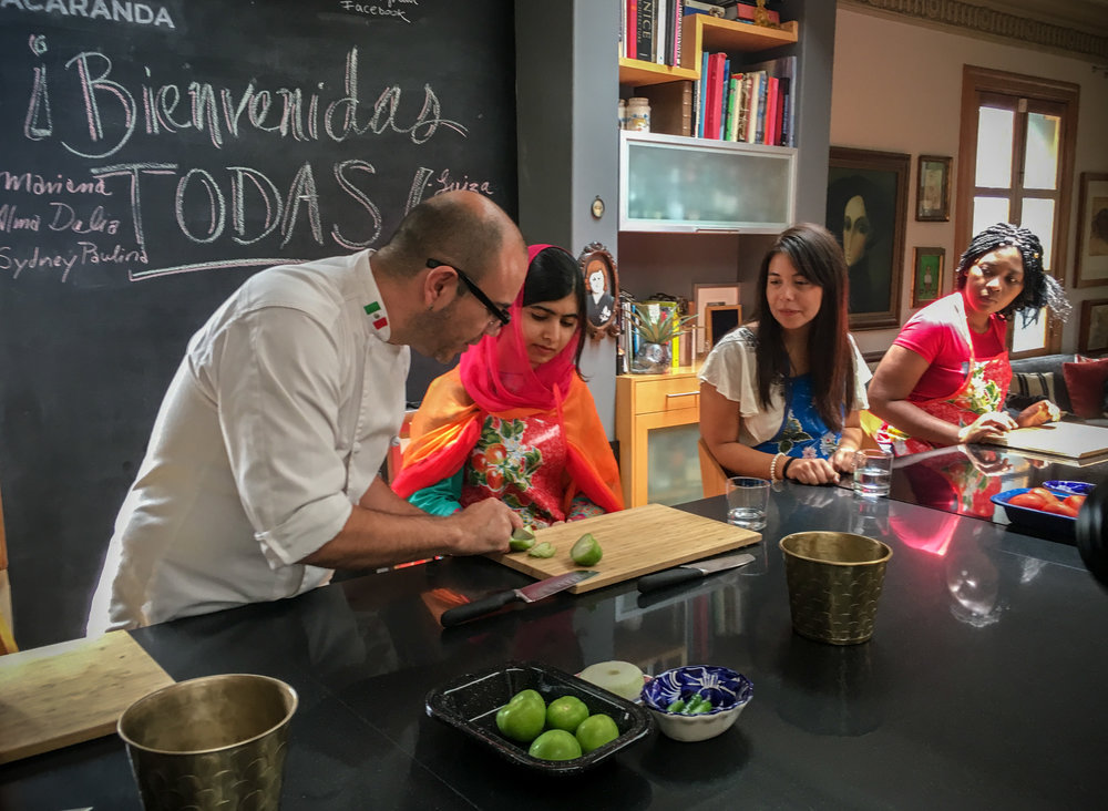 Malala Youzafsai taking a cooking class at Casa Jacaranda in Mexico City.