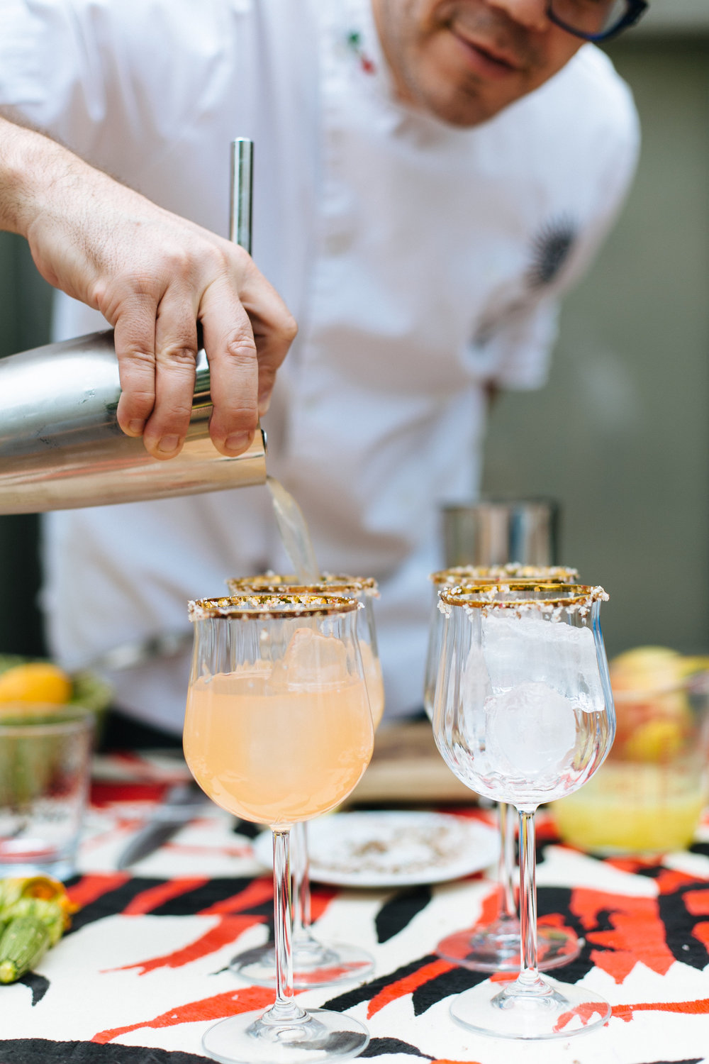 man serving cocktails with Altos tequila