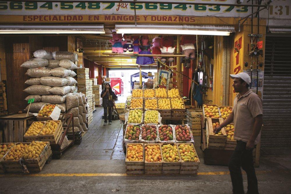 cartes full of mangos at a Mexico City market