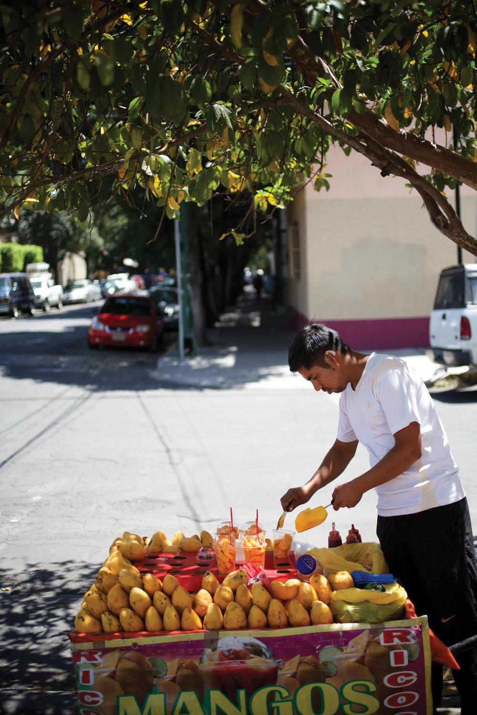 Mexico City street vendor selling mangos