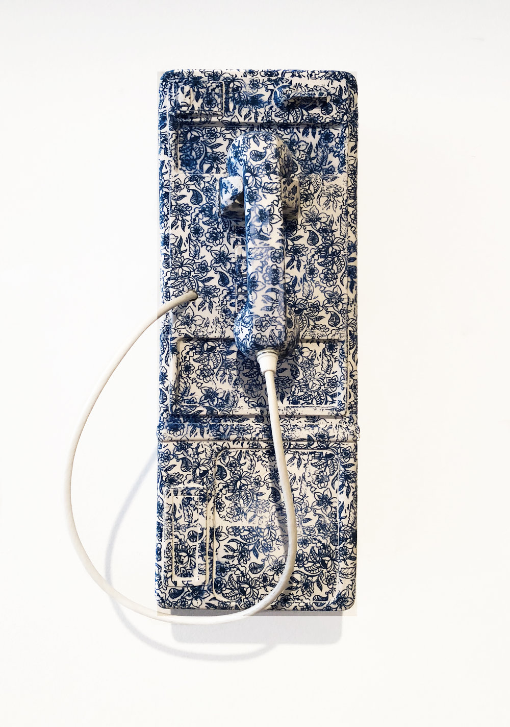 Brock DeBoer  1-800-BLU-WITE,  2018 porcelain, cobalt oxide, pendant cord 19 x 10 x 9 in.
