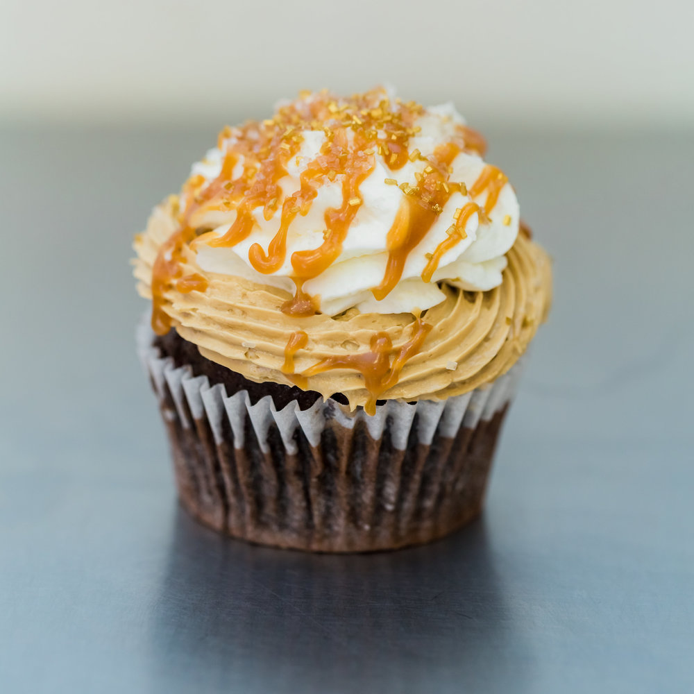 Salted Caramel Mocha - Chocolate cake frosted with espresso buttercream and whipped cream, garnished with a caramel drizzle and salt-sugar sprinkle