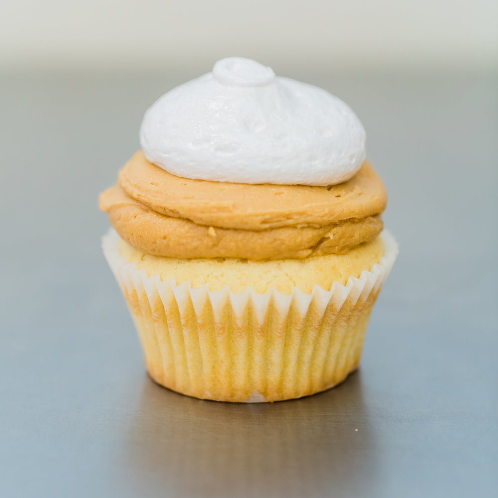 Fluffernutter - Vanilla cake topped with peanut butter buttercream and marshmallow frosting