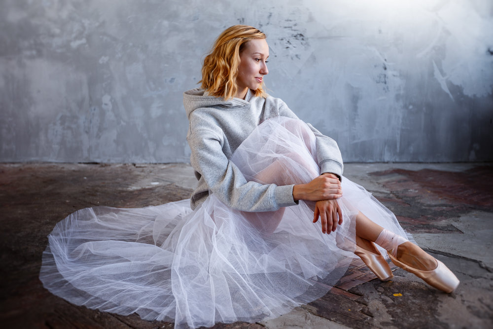 Young-and-slim-ballet-dancer-is-posing-in-a-stylish-studio-with-big-windows-881102552_5023x3349.jpeg