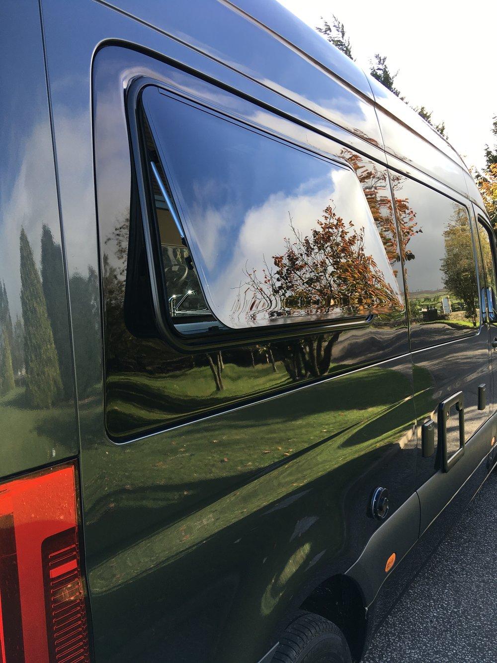 Side rear double glazed, open out windows