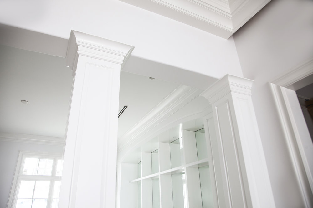 custom white painted column cabinetry