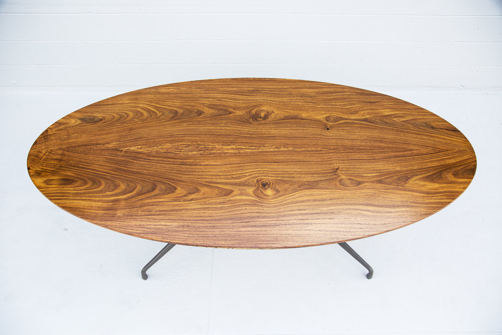 rosewood oval slab dining table