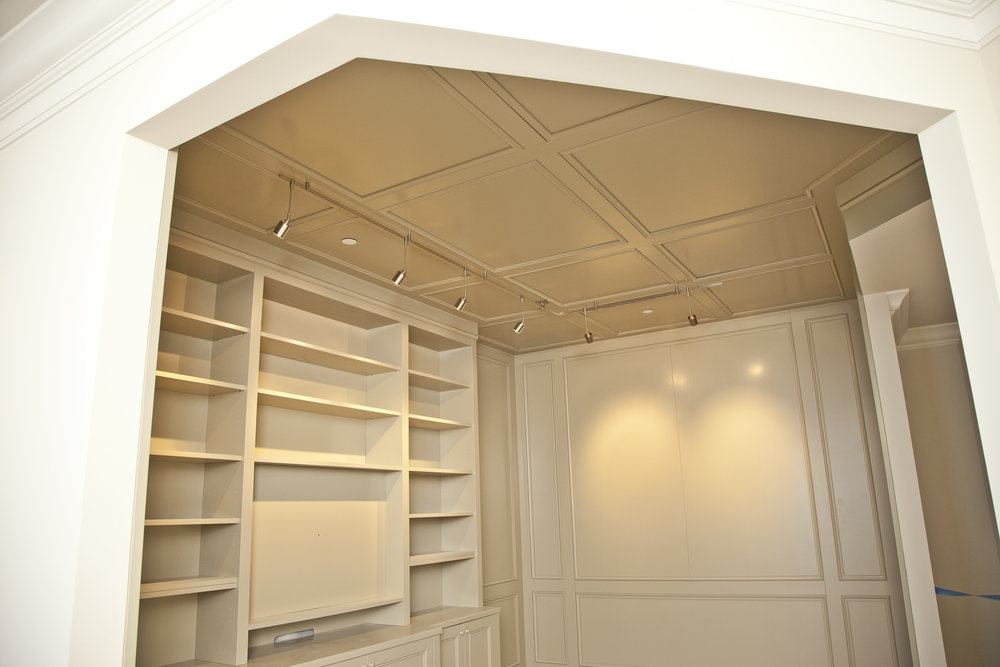 built in wood cabinetry and ceiling