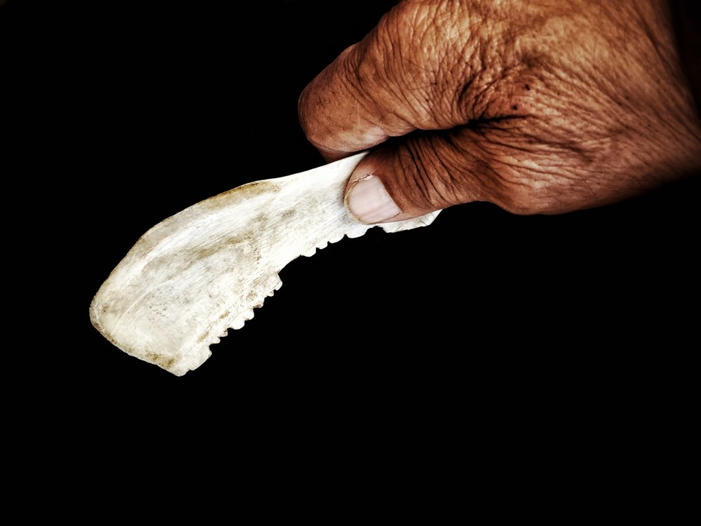 Deer Bone Blade in Grandfather's Hand
