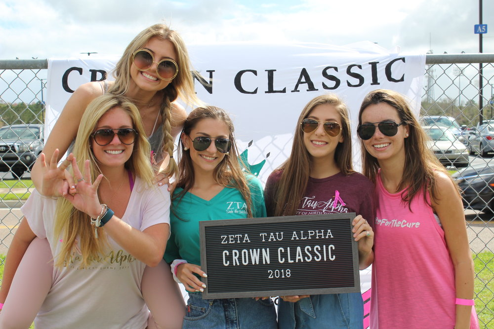 Zeta Tau Alpha - Nickname: ZetaColors:Turquoise Blue and Steel GreySymbol:5-Point Crown and a StrawberryFlower:White VioletMotto: