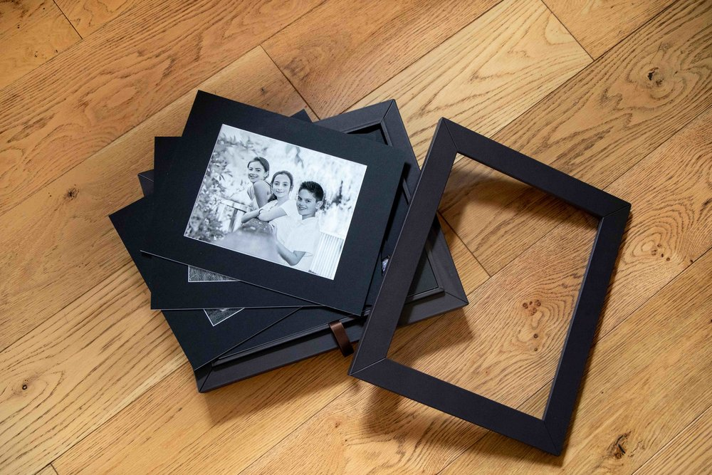 Italian leather heirloom reveal box and matted fine art prints with various capacity to hold and present your memories.