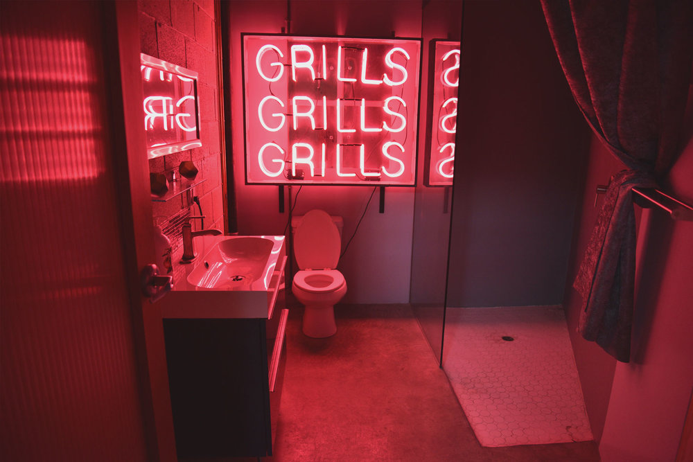 SocialSet - Bathroom with Neon Grills, Grills, Grills Sign