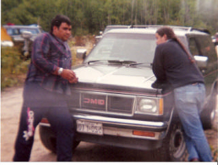 Russell Diabo (ABL Advisor) and Algonquins of Barriere Lake Chief Jean Maurice Matchewan talking during logging blockade, circa 1989.