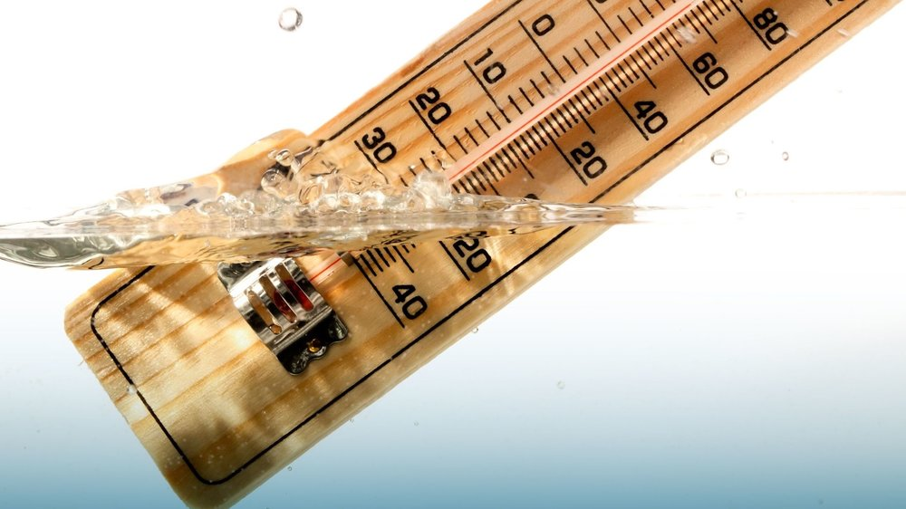 bigstock-Thermometer-measures-the-tempe-39036352-compressed.jpg