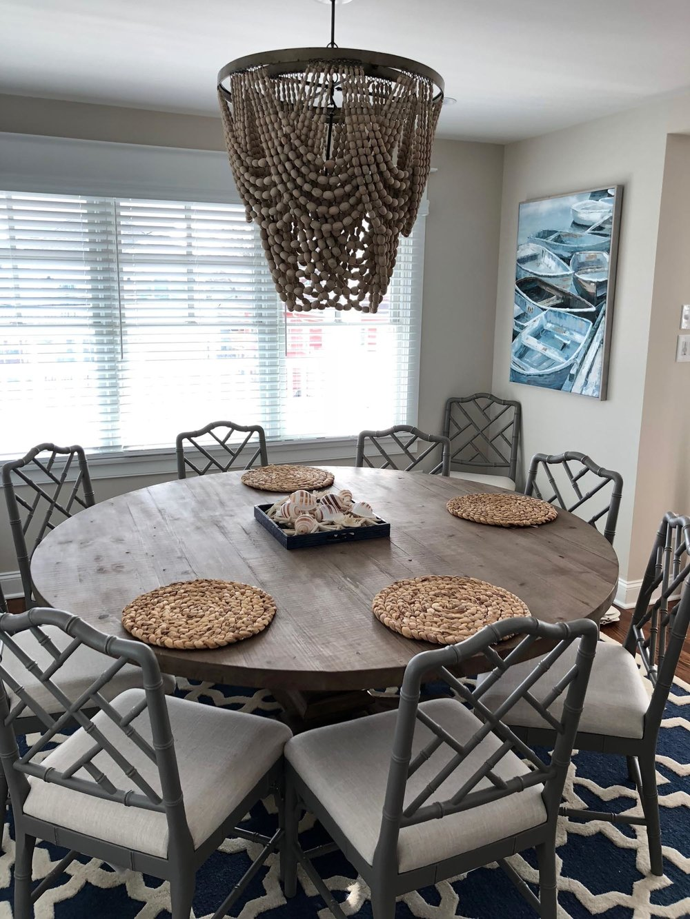 Breakfast nook with wooden round table and chairs