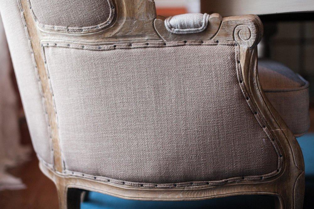 Base of beige burlap textured chair