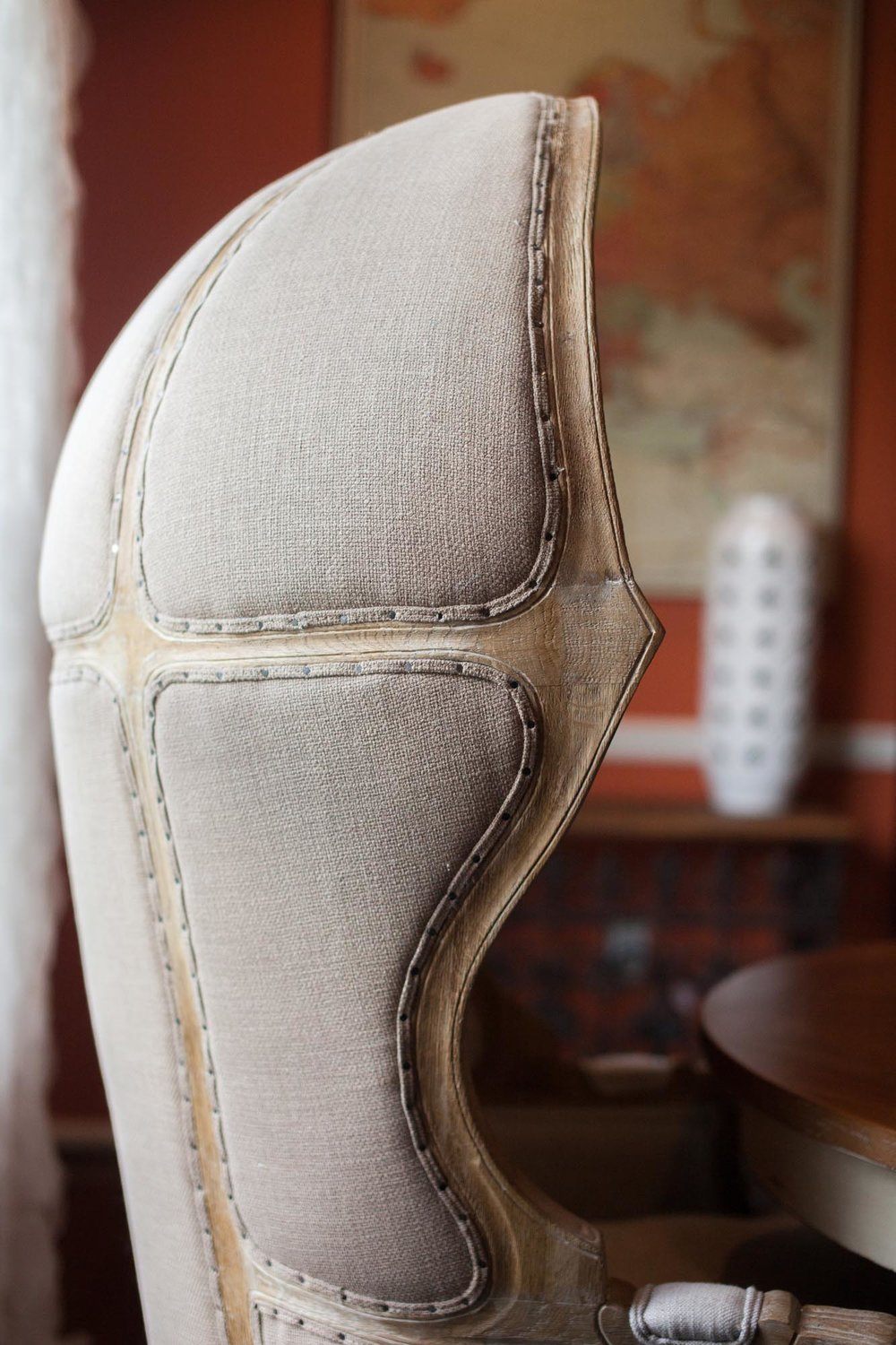 High back of beige burlap textured chair