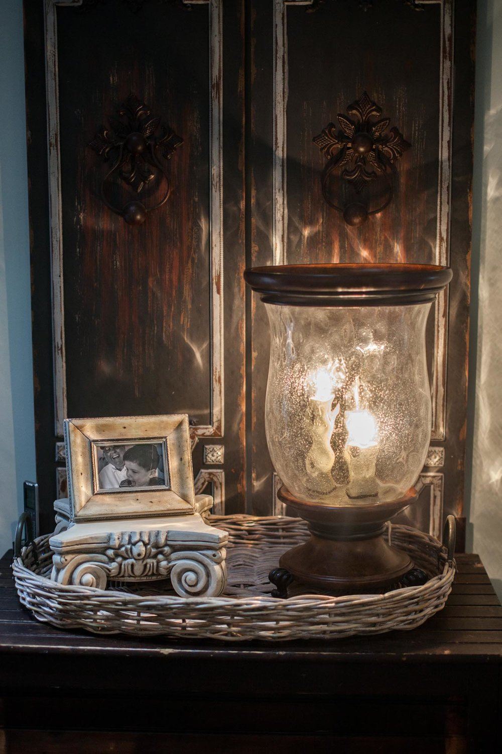 Antique console with gas lamp and framed picture