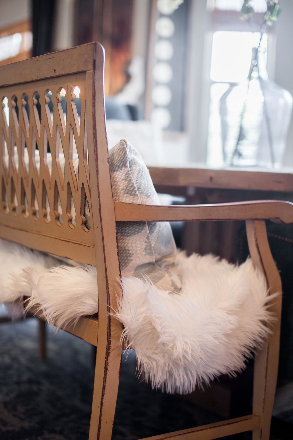 Wooden bench with soft fur throw