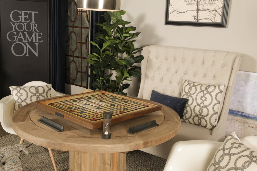 Round wooden game table with scrabble board
