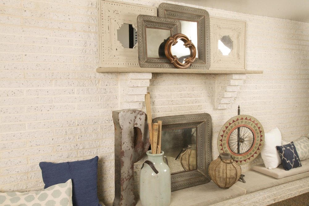 Fireplace and mantle with pillows and accessories