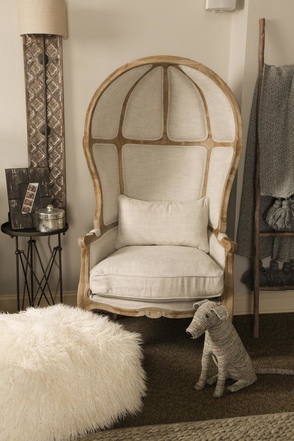 High backed beige colored chair