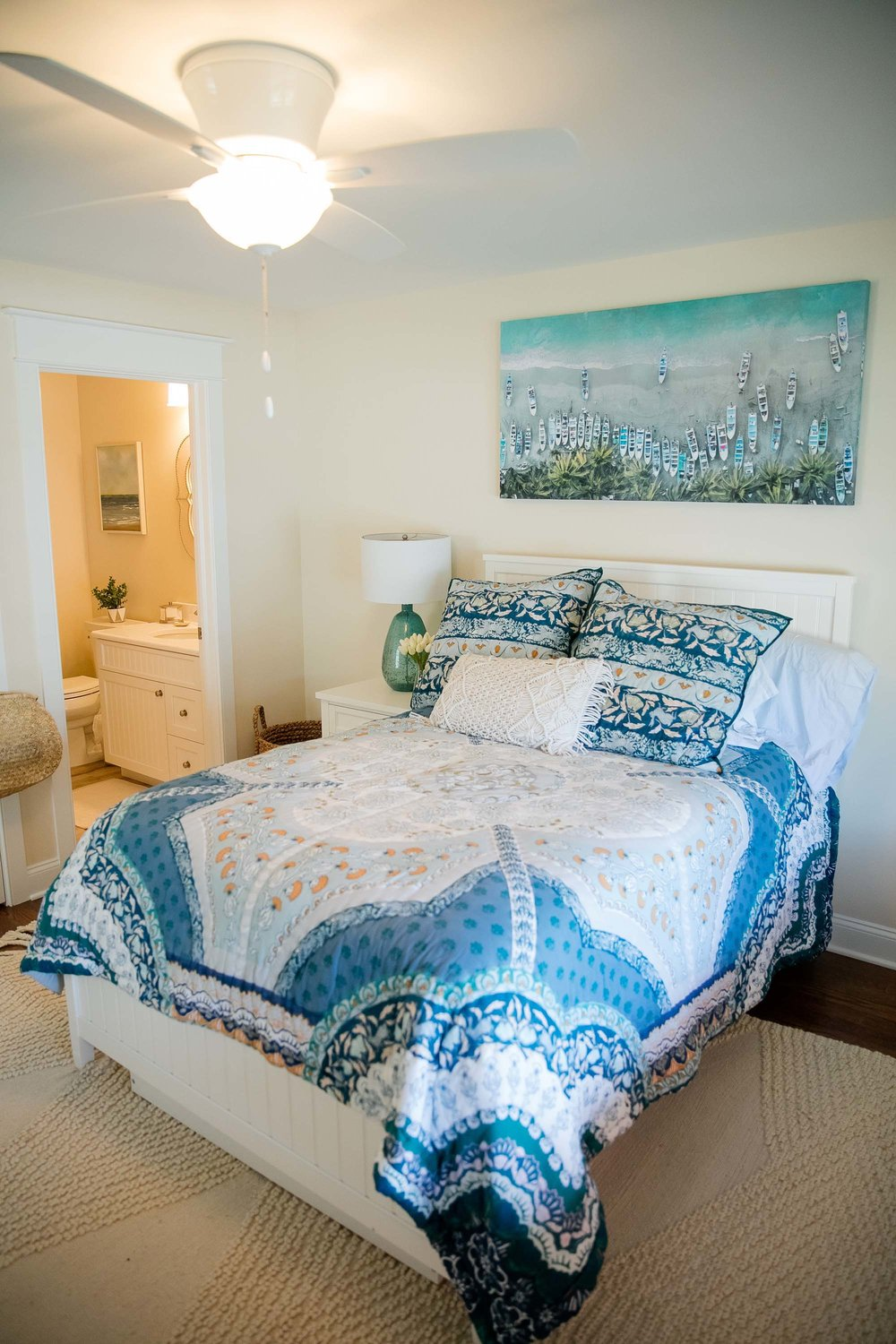 Double bed with bright blue and white bed covering
