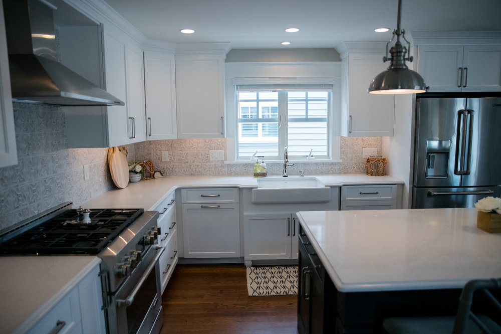 Modern kitchen with white granite counters