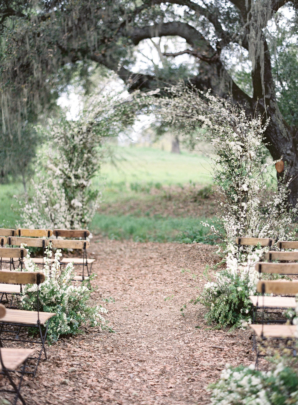 - Starting with the ceremony, Winward and her team created a full dramatic arch for the couple's backdrop. The arch was constructed of incredible blooming branches that are only available for a couple of weeks during the season. After cocktails, guests moved into the barn at Durham Ranch for dinner under a magical ceiling installation of green vines and delicate hanging candles.