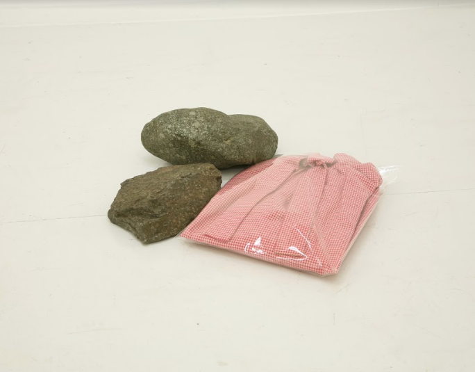 Eri Takayanagi, Clothes and Stones, 2011, Clothes, plastic bag, stones, 10.5 x 42 x 39.5 cm