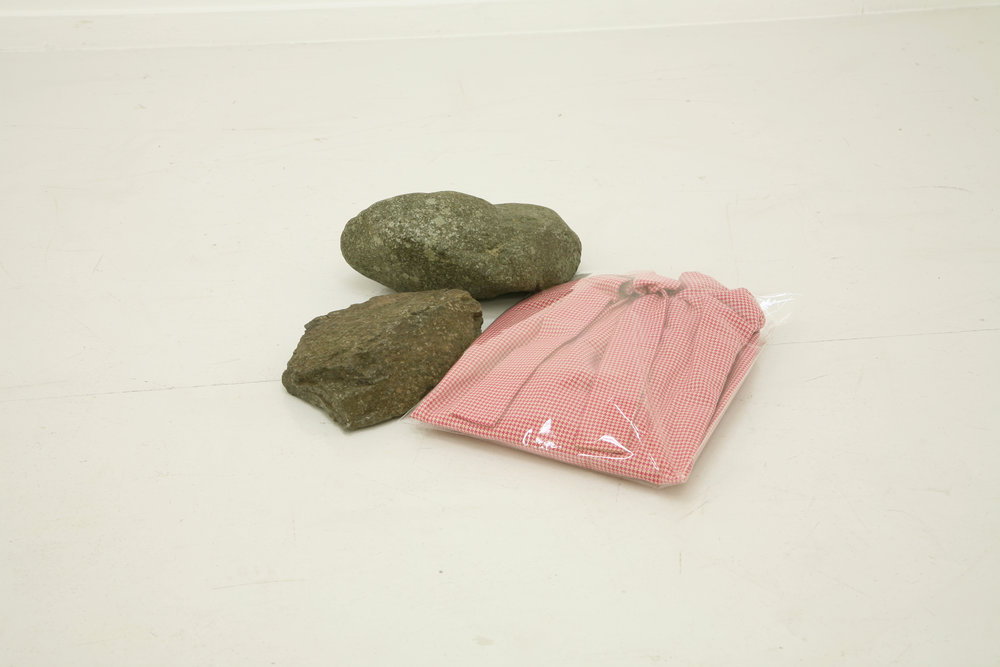 Eri Takayanagi, Clothes and Stones, 2011, Clothes, plastic bags, stones, 10.5 x 42 x 39.5 cm. Courtesy: the artist and Talion Gallery