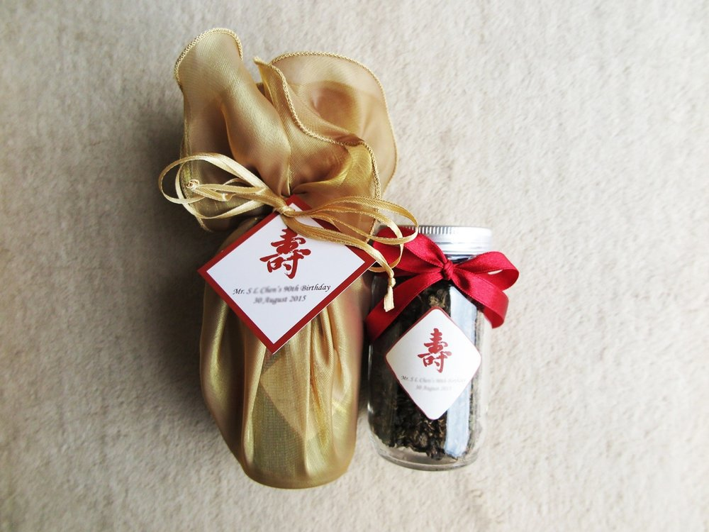 large_tea_bottle_with_organza_wrapping_med_res_.jpg